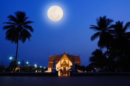 Thai Temple in full moon night photo