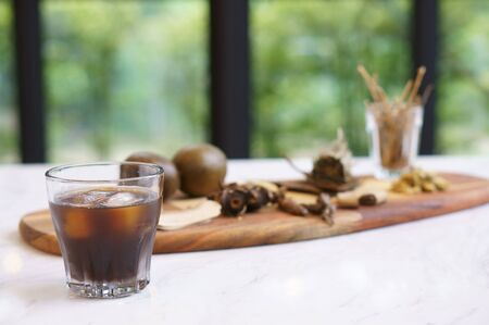 A glass of chinese mixed herbal drinks.