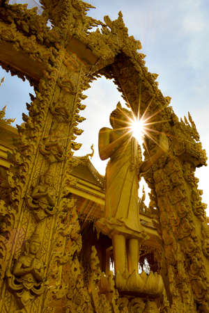 The sun in front of the buddha statue Stok Fotoğraf