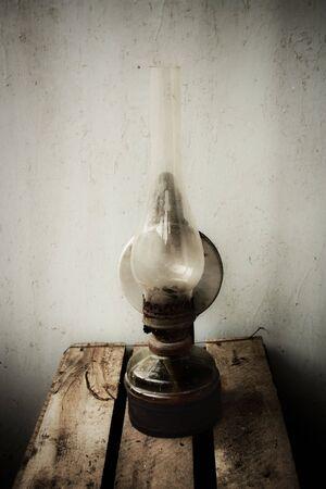 Old rust oil lamp photo