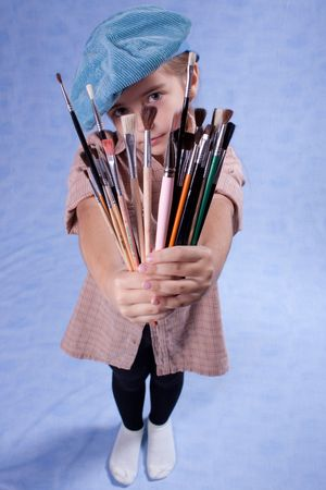 Little painter and set of brushes photo
