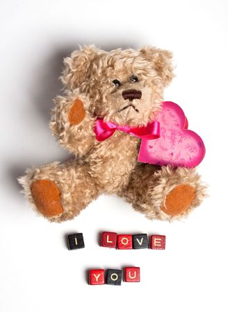 Teddy bear with heart. Isolated. Valentines photo