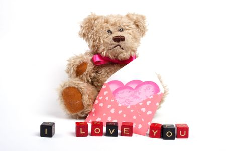 Teddy bear sitting  with heart. Valentines day theme photo