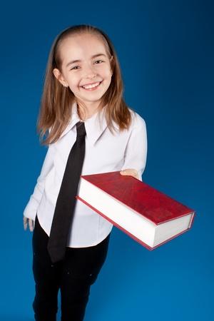 Little girl giving a book photo
