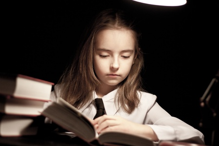 reading lamps: Girl reading book under lamp