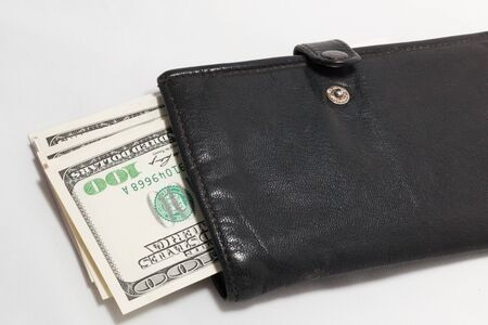 Wallet with money inside it  Over white background photo
