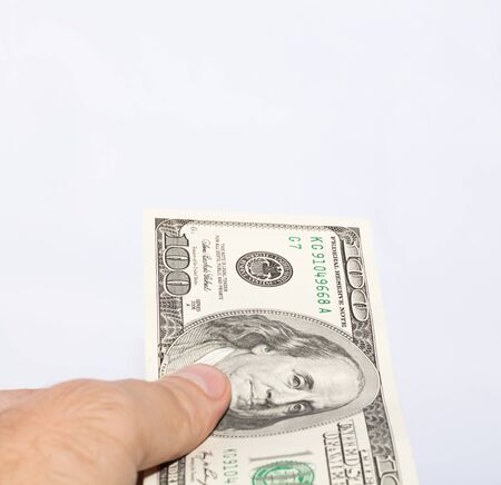 payoff: Hand holding money  Giving to  Stock Photo