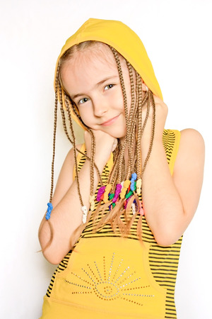 dreadlock: Young girl with dreadlocks and yellow blouse Stock Photo