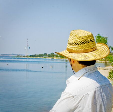 rest day: Man at holidays rest at sunny day seaside. Stock Photo