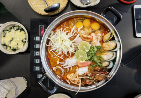 crab pot: Tom Yum Goong and seafood .spicy soup with shrimp mussel crab squid egg in a hot pot,thai cuising