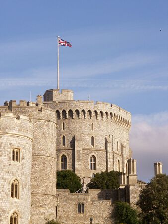 slits: The Union Jack flies over the round tower at Windsor Castle. It is changed to the Royal Standard when the Queen is in residence