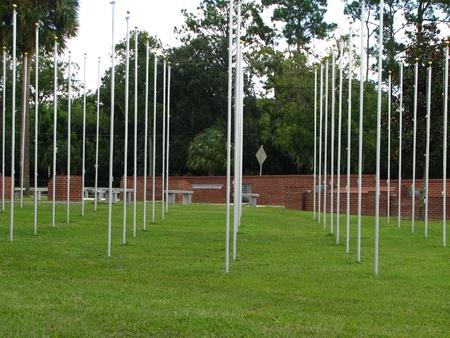 flagpoles: Empty flagpoles in Veterans park