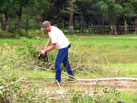 trimmer: man using chainsaw