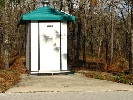 latrine: Modern outhouse in forest Stock Photo