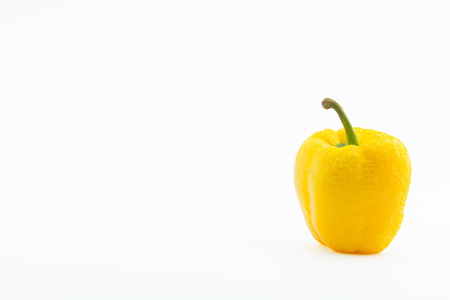 atrophy: Wither yellow pepper, isolated on white. Stock Photo
