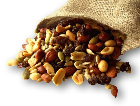 Trail mix of nuts, seeds, and dried fruit. Healthy snacking, on white background