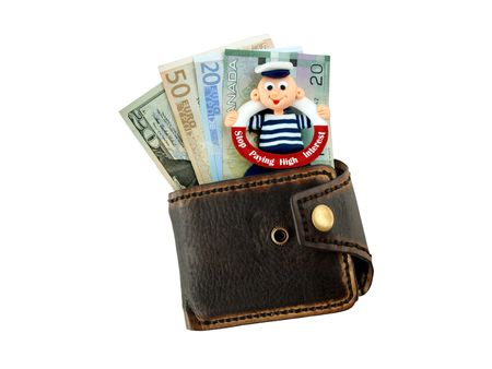 purse with banknotes and funny sign Stop Paying High Interest Stock Photo - 7577048