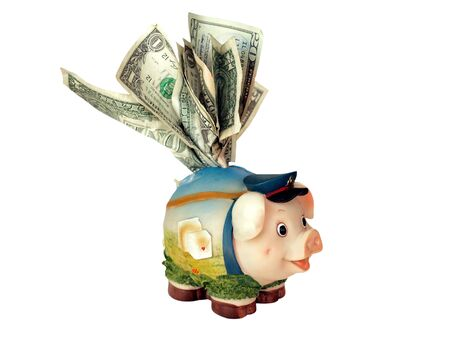 overstuffed funny piggy bank with dollar banknotes  Stock Photo