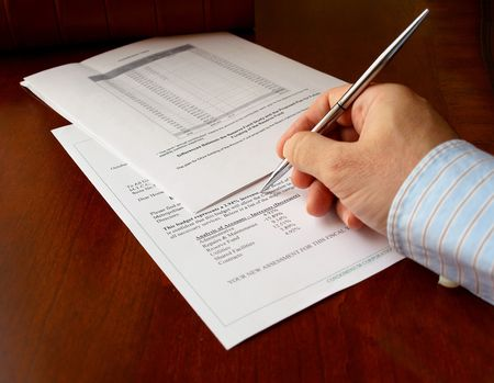 male hand with pen on the budget document