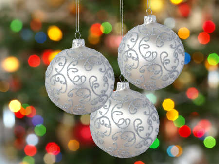 silvery: Three silver  balls  on Christmas tree background