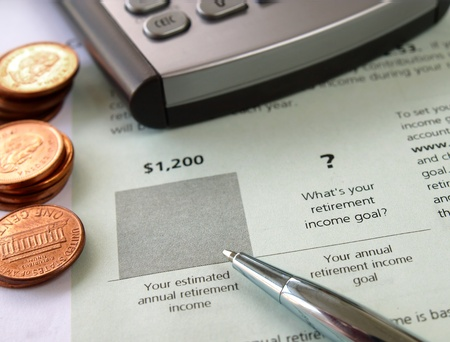 Pen on the financial document with calculator and coins       photo
