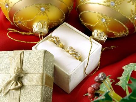 christmas decoration, diamond earrings and gift box   photo