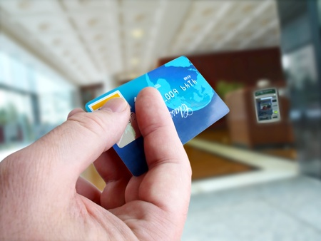 Male hand with credit card  版權商用圖片