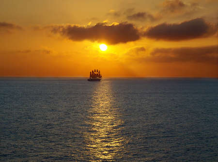 Romantic frigate sailing on sea sunset . Stock Photo - 9662151
