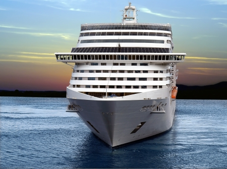 ocean liner: Luxury cruise ship sailing from port on sunset.