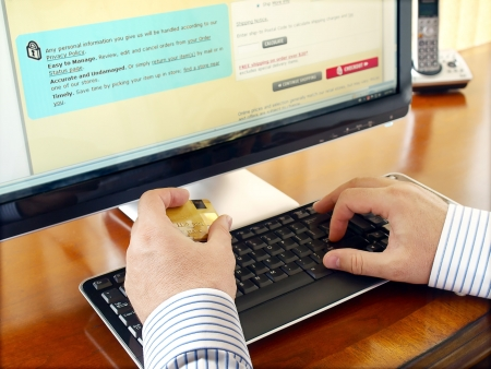 checkout: Businessman with credit card using computer for online purchase. Stock Photo