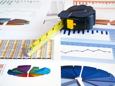 Tape measure on the investment charts.