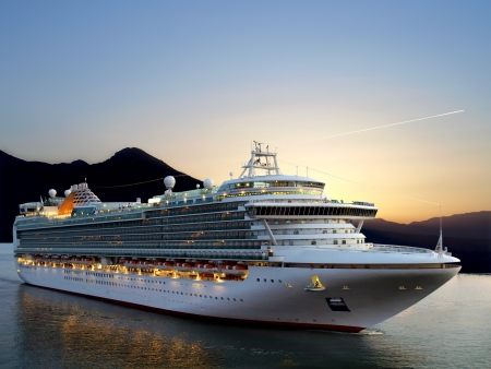 liner: Luxury cruise ship sailing from port on sunrise.  Stock Photo
