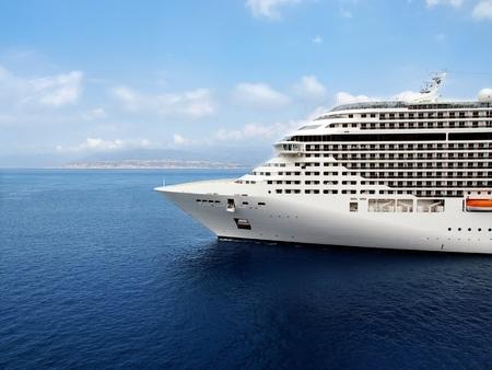Luxury cruise ship sailing from port.  Stock Photo