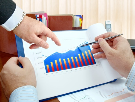Closeup of hands with financial  charts  at business meeting in the office. 版權商用圖片