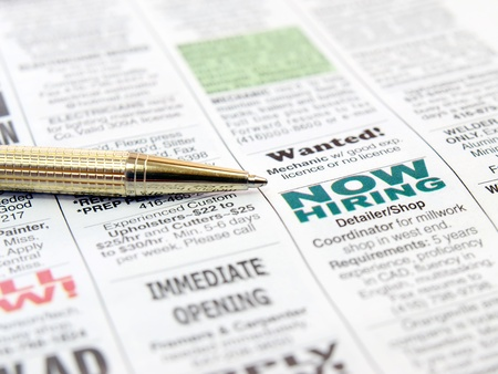 job hunt: Pen on the newspaper career opportunity ad.