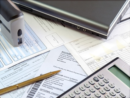 Accounting tools and bills on the table.  Archivio Fotografico
