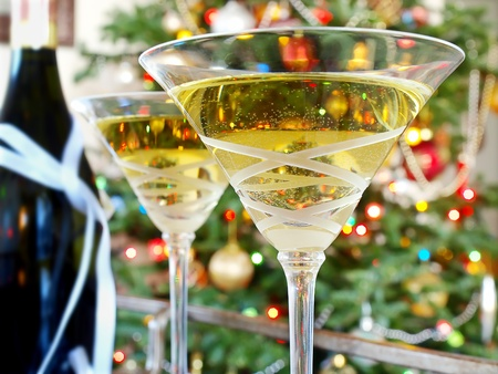 Crystal martini glasses with wine bottle on the trolley       photo