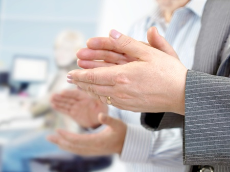 people clapping: Business team applauding in the meeting room