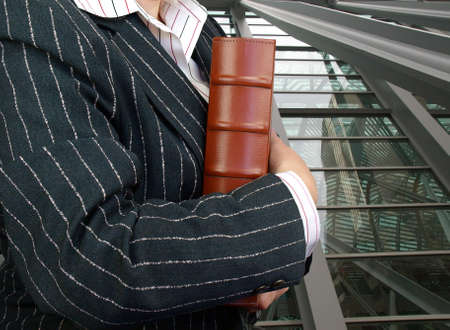 Businesswoman with leather folder ready for meeting. Stock Photo - 10711106