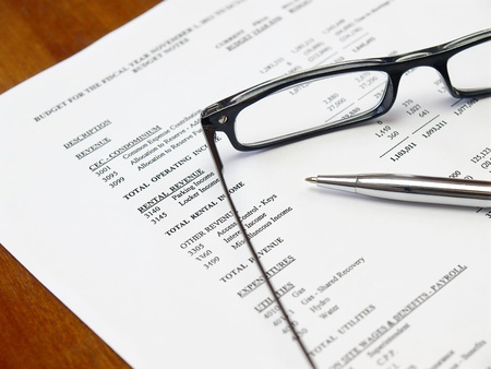 contracts: Glasses and pen on the budget document
