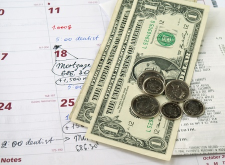 tipping: Receipts with dollar bills and coins on the monthly planner Stock Photo