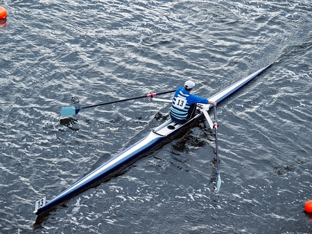 rower: Man single in boat during rowing regatta Stock Photo