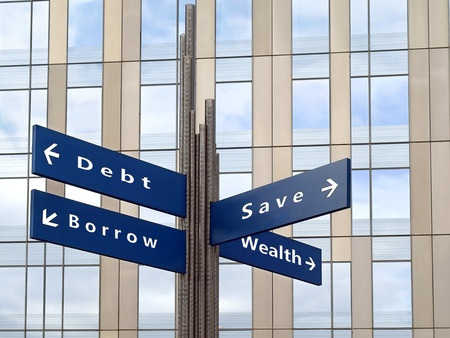 financial issues: Financial decisions direction sign with office building in background  Stock Photo