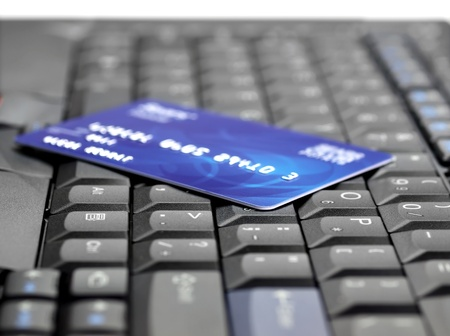 Credit card on computer keyboard photo
