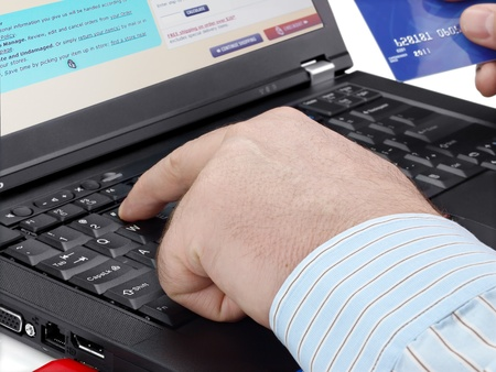 technology transaction: Businessman with credit card using computer for online purchase Stock Photo