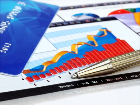 Credit card and pen on the charts  Stock Photo - 11571175