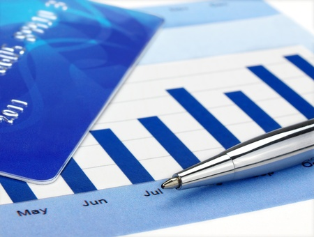Credit card and pen on the chart