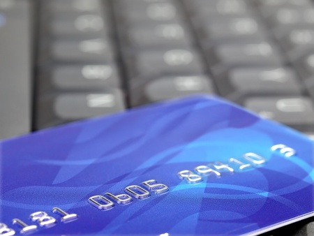 Closeup of credit card on computer keyboard photo