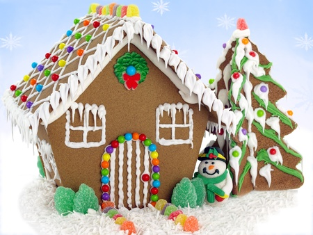 Gingerbread house and christmas tree on the snowflake background