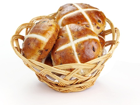Cross buns  Basket with fresh hot cross buns  photo